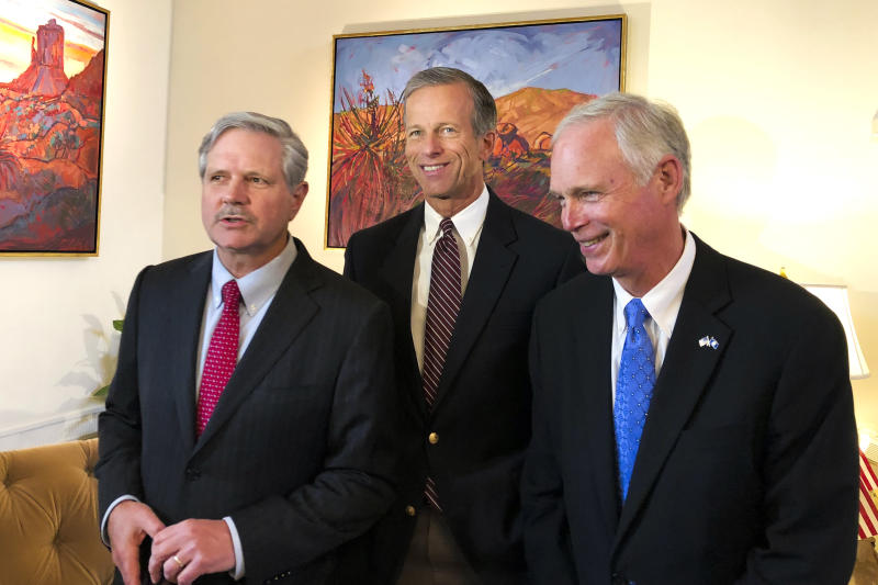 U.S. Sen. John Hoeven R-N.D. left Sen. John Thune R-S.D. center and Sen. Jerry Moran R-Kan. chairman of the Subcommittee on Consumer Protection Product Safety Insurance and Data Security speak to the Associated Press in the U.S. Embassy in Mos