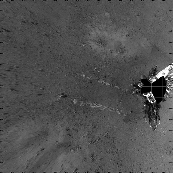 """NASA's Mars rover Curiosity took this image its landing site """"Bradbury Landing"""" on Aug. 22, 2012, after a successful test drive. The landing site is named in honor of the late science fiction author Ray Bradbury, and taken on what would have be"""
