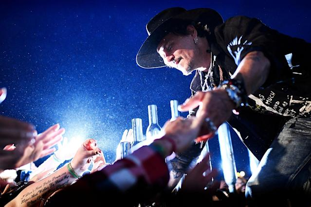 <p>Actor Johnny Depp greets fans before presenting his film The Libertine, at Cinemageddon at Worthy Farm in Somerset during the Glastonbury Festival in Britain, June 22, 2017. (Photo: Dylan Martinez/Reuters) </p>