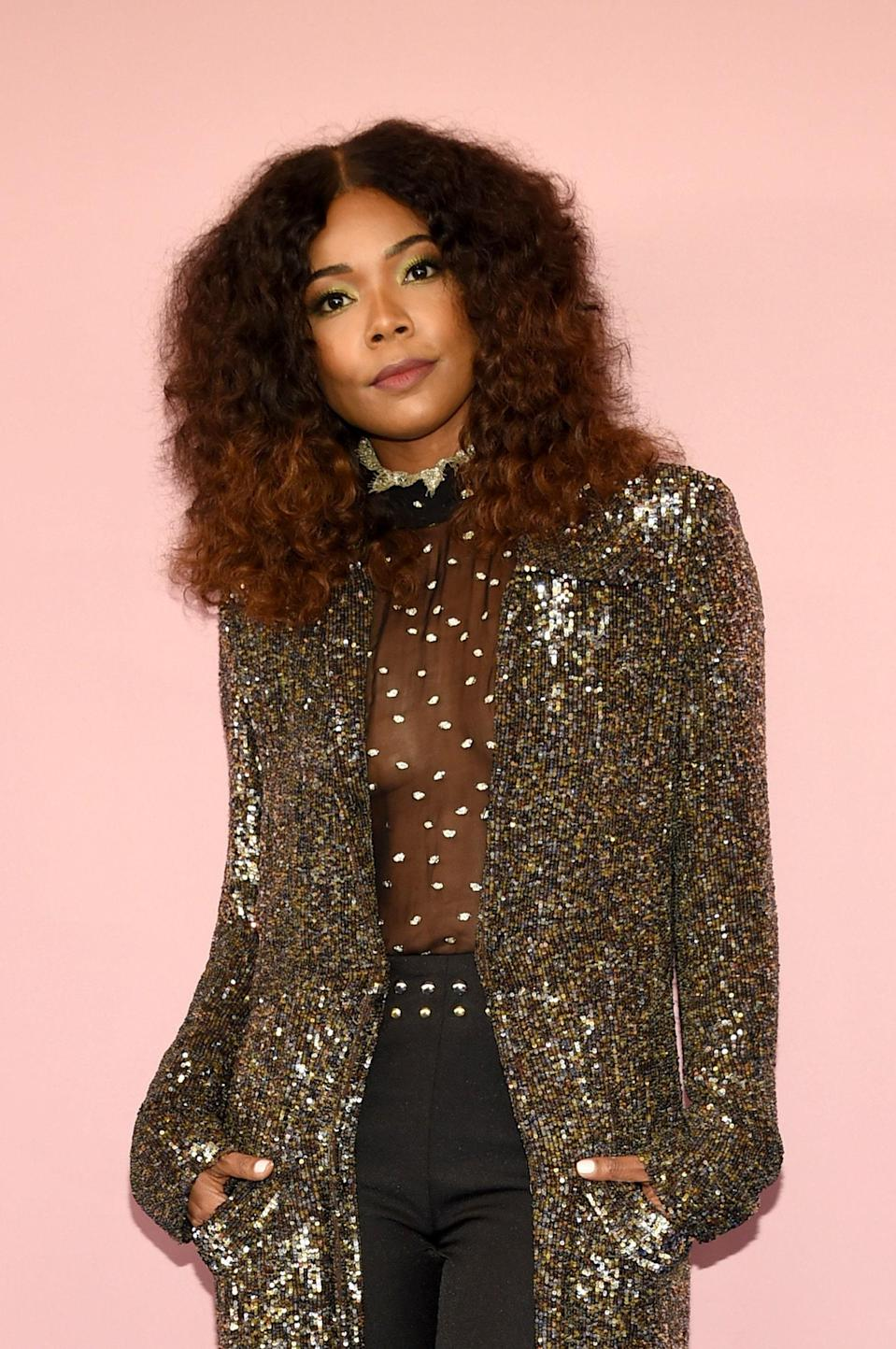 """To get curls to really pop, add a variation of warm shades on roots and ends. To get a similar look at home, celebrity hairstylist <a href=""""https://www.instagram.com/derickmonroe/?hl=en"""" rel=""""nofollow noopener"""" target=""""_blank"""" data-ylk=""""slk:Derick Monroe"""" class=""""link rapid-noclick-resp"""">Derick Monroe</a> recommends <a href=""""https://amzn.to/2V5dsFY"""" rel=""""nofollow noopener"""" target=""""_blank"""" data-ylk=""""slk:Dark & Lovely Fade Resist in Chestnut Brown"""" class=""""link rapid-noclick-resp"""">Dark & Lovely Fade Resist in Chestnut Brown</a> at the roots and <a href=""""https://amzn.to/3m9hHvQ"""" rel=""""nofollow noopener"""" target=""""_blank"""" data-ylk=""""slk:Honey Blonde"""" class=""""link rapid-noclick-resp"""">Honey Blonde</a> on ends. Since both colors are on the warm side, the result doesn't look fake, just super dimensional and pretty."""