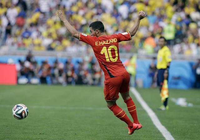 Belgium's Eden Hazard attempts to control the ball during the group H World Cup soccer match between Belgium and Algeria at the Mineirao Stadium in Belo Horizonte, Brazil, Tuesday, June 17, 2014. (AP Photo/Hassan Ammar)