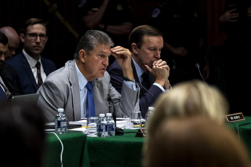 Sen. Joe Manchin (D-W.Va.), center, and Sen. Christopher Murphy (D-Conn.), right, during a Senate Appropriations Committee markup meeting about defense, energy and water bills, on Capitol Hill in Washington, Sept. 12, 2019. (Anna Moneymaker/The New York Times)