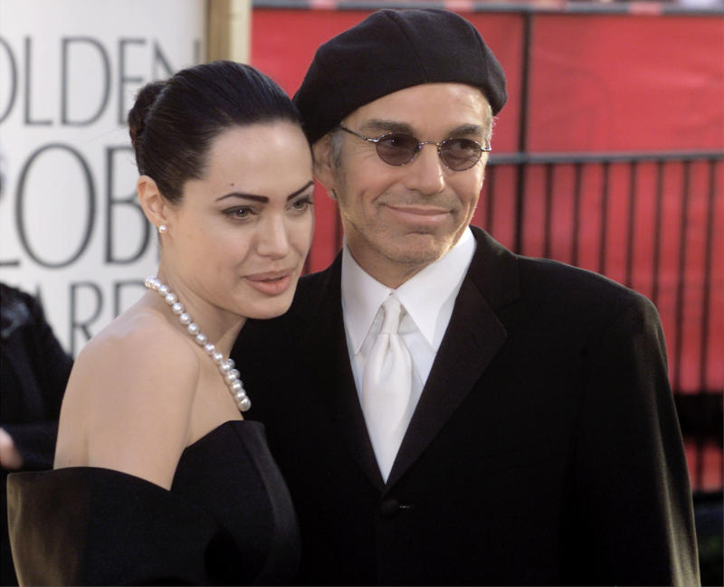Billy Bob Thornton (R) and actress wife Angelina Jolie pose during arrivals at the 59th annual Golden Globe Awards in Beverly Hills, January 20, 2002. Thornton is nominated for Best Actor in a Motion Picture - Drama, and Comedy or Musical categories. REUTERS/Fred Prouser JH/SV