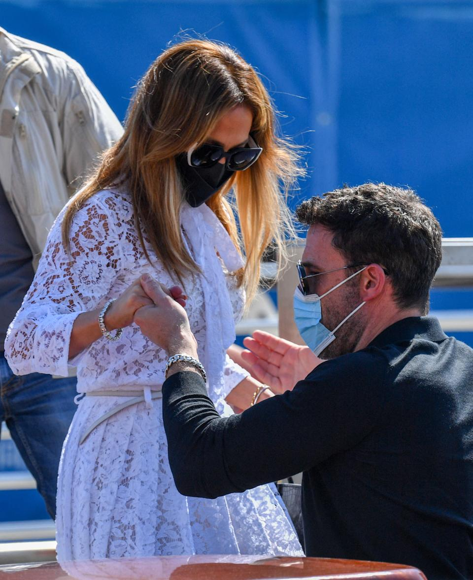 Ben Affleck helps US actress and singer Jennifer Lopez as they board a vaporetto taxi boat on September 9, 2021 after they arrived to attend the 78th Venice Film Festival in Venice. (Getty Images)