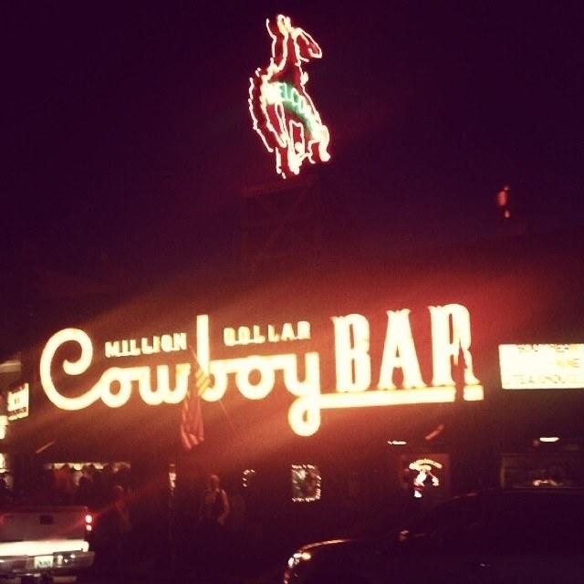 Whitney Cummings took a trip to Jackson Hole for Sandra Bullock's birthday at the legendary Cowboy Bar in 2014.