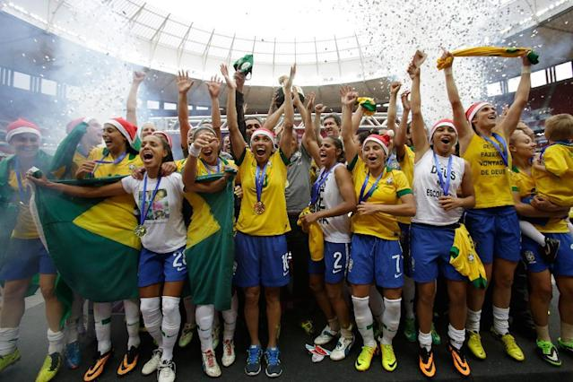 Brazil players celebrate after a 5-0 victory over Chile during the final soccer match at the International Women's Football Tournament in Brasilia, Brazil, Sunday, Dec. 22, 2013. Brazil won the tournament. (AP Photo/Eraldo Peres)