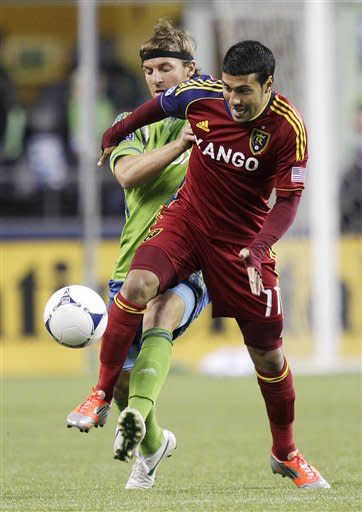 Real Salt Lake's Javier Morales (11) and Seattle Sounders' Jeff Parke, left, vie for the ball in the first half of an MLS soccer match, Wednesday, Oct. 17, 2012, in Seattle. (AP Photo/Ted S. Warren)