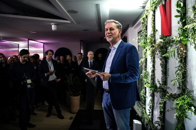 Co-founder and director of Netflix Reed Hastings delivers a speech as he inaugurates the new offices of Netflix France, in Paris