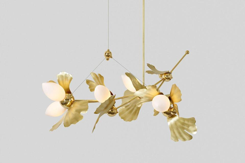 """<p>Looking at <a href=""""https://www.rosieli.com/"""" rel=""""nofollow noopener"""" target=""""_blank"""" data-ylk=""""slk:Rosie's Li"""" class=""""link rapid-noclick-resp"""">Rosie's Li</a>'s sculptural lighting, the last thing one would see is a reference to traditional Chinese painting. But in fact, her early study of this classical artform greatly shaped her point of view. """"Growing up I trained in traditional Chinese painting, both Guo Hua and Gong Bi, which felt like two opposite approaches to me. I learned to express the most with as few brush strokes as possible (Guo Hua) and honed the meticulous craft of painting detailed flowers, tree branches, birds, etc (Gong Bi),"""" says Li. """"My traditional training continues to show in our lighting designs. I definitely have a soft spot for decorative arts and try to strike a balance between overall gesture and tight craft details."""" This design dichotomy is clearly evident throughout Li's fanciful work, where natural and organic references blend seamlessly with a strict geometry to create fixtures that delight and shine.</p>"""