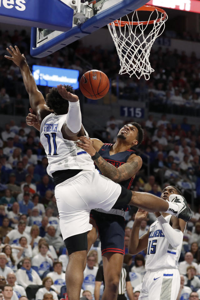 Dayton's Ibi Watson loses control of the ball on his way to the basket as Saint Louis' Hasahn French (11) defends during the first half of an NCAA college basketball game Friday, Jan. 17, 2020, in St. Louis. (AP Photo/Jeff Roberson)