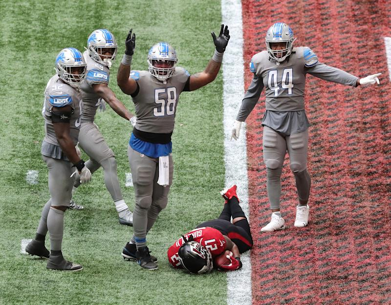 "Lions linebacker Jamie Collins signals ""touchdown"" as Falcons running back Todd Gurley tries to stop short of the end zone to control the final minutes of the clock in the fourth quarter of the Lions' 23-22 win on Sunday, Oct. 25, 2020, in Atlanta."