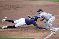 Minnesota Twins' NickGordon, left, beats the throw to Houston Astros first baseman Yuli Gurriel on a pickoff-attempt in the third inning of a baseball game, Saturday, June 12, 2021, in Minneapolis. (AP Photo/Jim Mone)