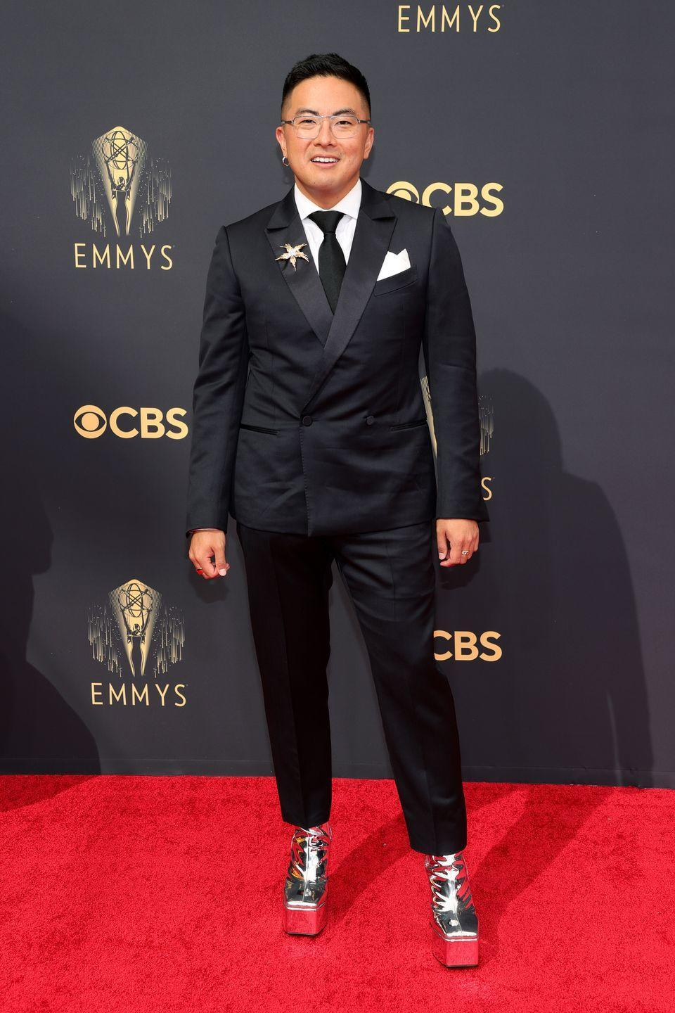 <p>The suit fits great and the brooch is a nice touch, but you can't talk about Bowen Yang's fit without talking about those shoes. </p><p><em>In </em><em>Ermenegildo Zegna, Syro heels, and a Tiffany & Co. broach</em></p>