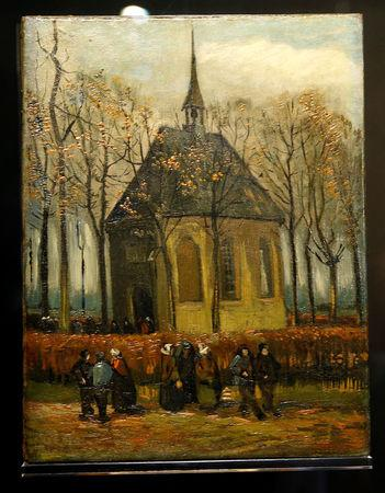 "The canvas ""Congregation Leaving The Reformed Church in Nuenen"", one of the two recovered paintings by Vincent van Gogh which were stolen from the Van Gogh Museum in 2002, is pictured at the van Gogh Museum in Amsterdam, Netherlands March 21, 2017.   REUTERS/Michael Kooren"