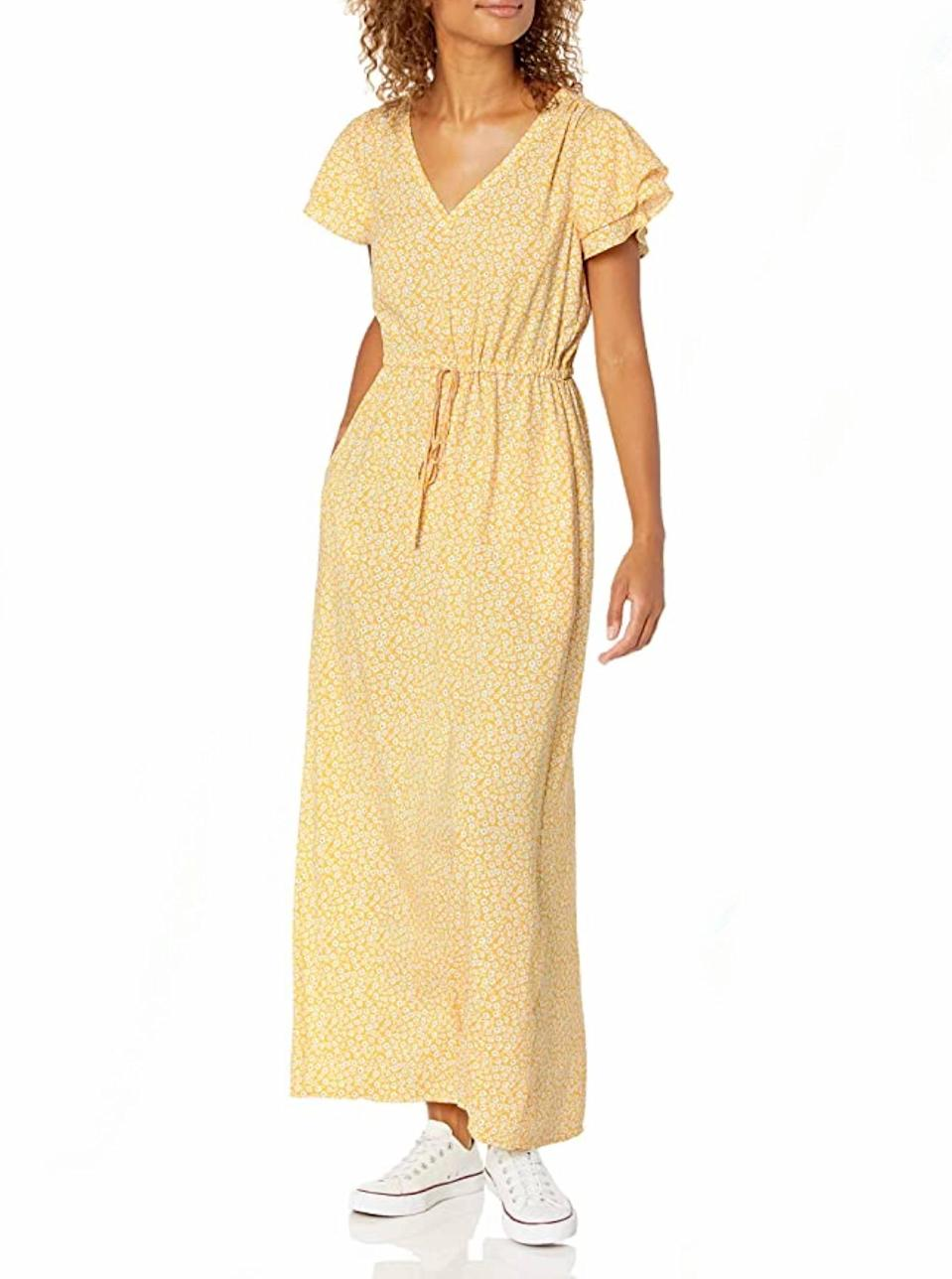 """Not here for a pop of yellow? Grab the neutral floral option and pair with chunky flats to channel <em>Reality Bites</em>. $30, Amazon. <a href=""""https://www.amazon.com/Amazon-Brand-Goodthreads-Georgette-Ruffle-Sleeve/dp/B07Y5LQBVP/"""" rel=""""nofollow noopener"""" target=""""_blank"""" data-ylk=""""slk:Get it now!"""" class=""""link rapid-noclick-resp"""">Get it now!</a>"""