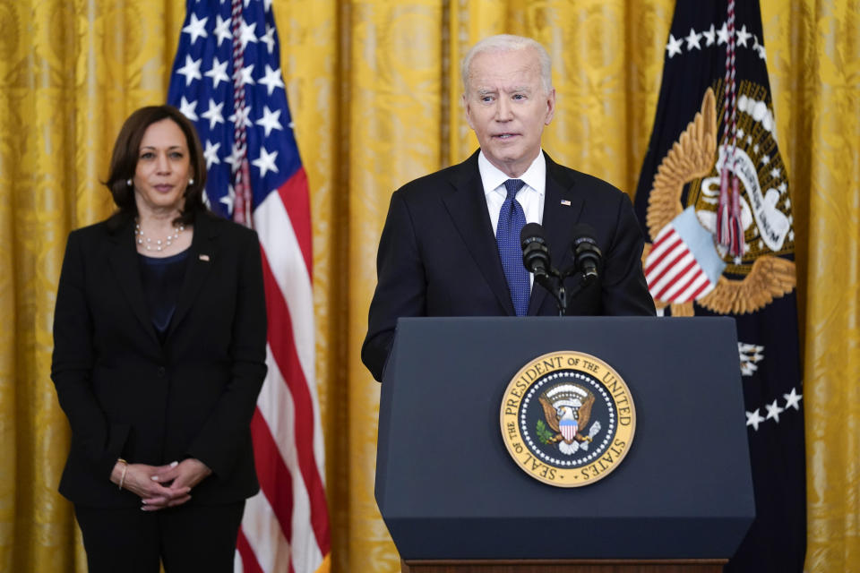 Vice President Kamala Harris listens as President Joe Biden speaks before signing the COVID-19 Hate Crimes Act, in the East Room of the White House, Thursday, May 20, 2021, in Washington. (AP Photo/Evan Vucci)