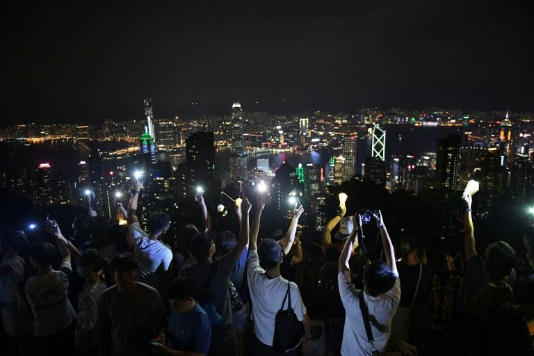 Demonstrators gathered on top on Hong Kong's hill to mark mid-autumn festival