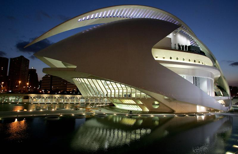 FILE In this Oct. 5, 2005 file photo, the Opera House is illuminated at twilight in Valencia, Spain just before it's official inauguration Spain's by Queen Sofia. The fate of a Christmas concert due to be held in Valencia's opera house was to be decided Friday after parts of the building's cladding fell in high winds. The music venue was designed by Valencia-born architect Santiago Calatrava and generated headlines in 2006 when it was revealed that its construction had cost more than euro 332 million ($455.6 million), a sum that was four times the original budget. Elsewhere, Spanish authorities are blaming high winds, torrential rain and crashing waves for the deaths of two bathers in the Canary Islands, the rescue of three others from the sea and temporary closing of an opera house due to falling masonry.(AP Photo/ Fernando Bustamante, File)