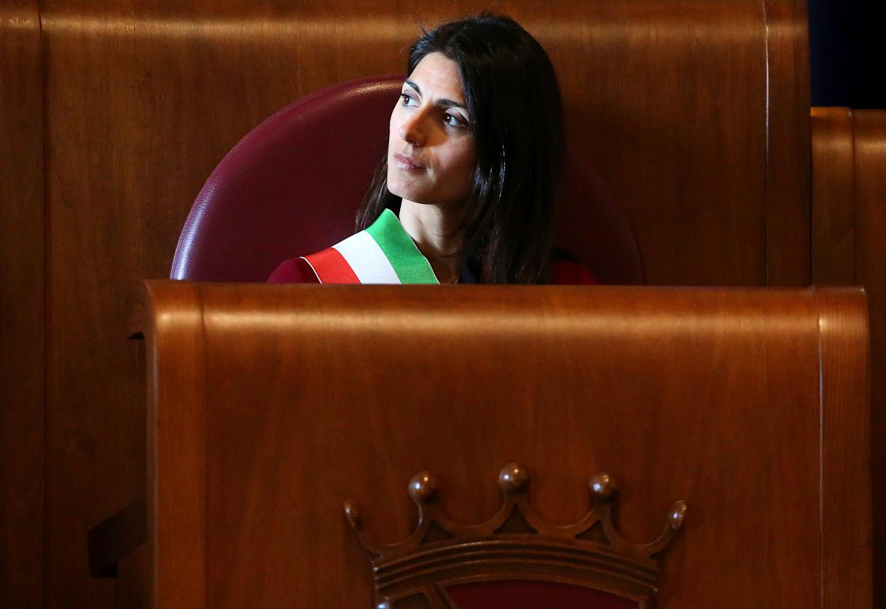 "Rome's mayor Virginia Raggi attends a ceremony where former Leicester City coach Claudio Ranieri  receives the ""Lupa Capitolina award"" at Rome's city hall in Rome, Italy, March 30, 2017. REUTERS/Alessandro Bianchi"