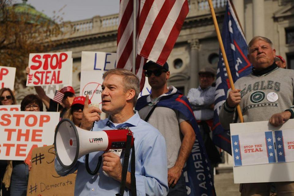 Representative Jim Jordan stands with dozens of people calling for stopping the vote count in Pennsylvania due to alleged fraud against President Donald Trump gather on the steps of the State Capital on November 05, 2020 in Harrisburg, Pennsylvania. The activists, many with flags and signs for Trump, have made allegations that votes are being stolen from the president as the race in Pennsylvania continues to tighten in Joe Biden's favor. (Photo by Spencer Platt/Getty Images)