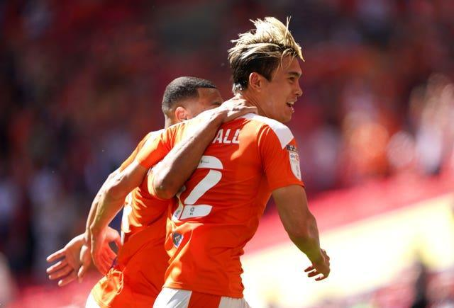 Kenny Dougall netted a brace as Blackpool won the League One play-off final on Sunday, beating Lincoln 2-1 (Zac Goodwin/PA).