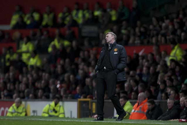 Manchester United's manager David Moyes watches as his team lose 2-1 to Swansea City in their English FA Cup third round soccer match at Old Trafford Stadium, Manchester, England, Sunday Jan. 5, 2014. (AP Photo/Jon Super)