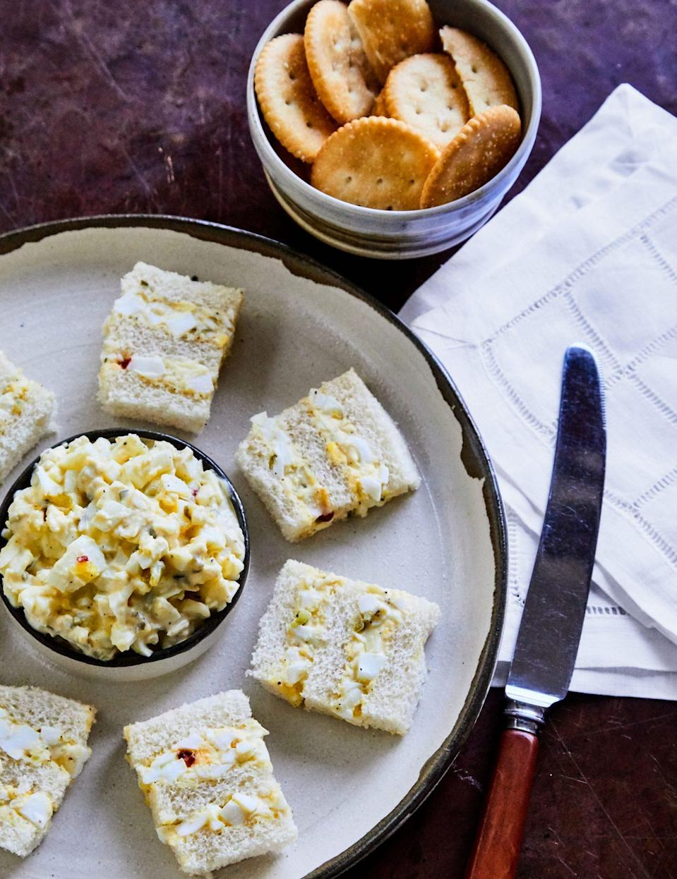 """<p><strong>Recipe: </strong><a href=""""https://www.southernliving.com/recipes/mamas-egg-salad"""" rel=""""nofollow noopener"""" target=""""_blank"""" data-ylk=""""slk:Vera Stewart's Egg Salad"""" class=""""link rapid-noclick-resp""""><strong>Vera Stewart's Egg Salad</strong></a></p> <p>""""There's something so nostalgic about the pairing of a hot summer afternoon and a cold, soft egg salad sandwich on pillowy Wonder Bread. If you don't already add Durkee Famous Sauce to your recipe, prepare to be hooked—if you can find it in the grocery store. My grandmother has been <a href=""""https://www.southernliving.com/dairy/eggs/durkee-sauce-deviled-eggs"""" rel=""""nofollow noopener"""" target=""""_blank"""" data-ylk=""""slk:sneaking it into her egg salad and deviled eggs"""" class=""""link rapid-noclick-resp"""">sneaking it into her egg salad and deviled eggs</a> for as long as I can remember, and you just can't beat the tangy flair. Vera Stewart's recipe is no-fuss and insanely simple, as egg salad should be."""" Kaitlyn Yarborough, Assistant Editor</p>"""