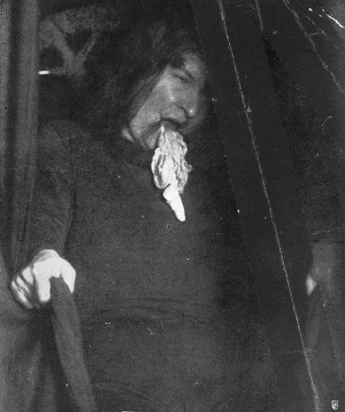 """<p>This photograph captures the moment ectoplasm materializes from the mouth of a medium during a spiritual seance. During seances in the late 19th century, the book <em>Victorian Review </em>states that <a href=""""https://muse.jhu.edu/article/744950/summary"""" rel=""""nofollow noopener"""" target=""""_blank"""" data-ylk=""""slk:mediums would spit out"""" class=""""link rapid-noclick-resp"""">mediums would spit out</a> """"fat slabs of curdled plasma—what the Nobel laureate physiologist Charles Richet would call 'ectoplasm.'"""" It was believed that this bodily substance was a physical representation of the spirit world coming through from the other side.</p>"""
