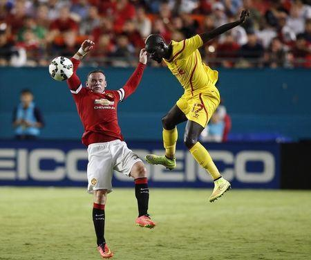 Aug 4, 2014; Miami Gardens, FL, USA; Liverpool defender Mamadou Sakho and Manchester United forward Wayne Rooney (10) battle for the ball with n the first half at Sun Life Stadium. Mandatory Credit: Robert Mayer-USA TODAY Sports