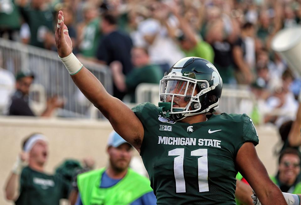 Aug 30, 2019; East Lansing, MI, USA; Michigan State Spartans running back Connor Heyward (11) celebrates a touchdown during the first quarter of a game against the Tulsa Golden Hurricane at Spartan Stadium. Mandatory Credit: Mike Carter-USA TODAY Sports