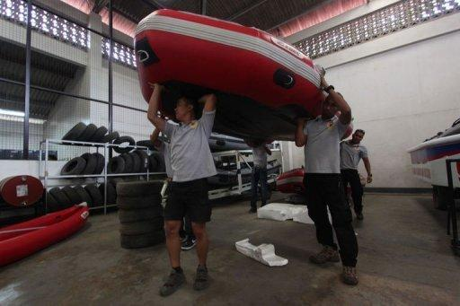<p>In anticipation of Typhoon Bopha, rescuers prepare equipment in Davao City, on the southern island of Mindanao. More than 53,000 people have moved into nearly 1,000 government shelters, the civil defence office says</p>