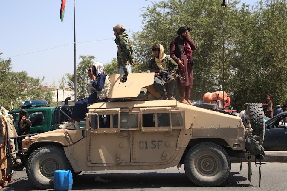 Afghan Taliban fighters are seen on a military vehicle in Kabul, capital of Afghanistan, Aug. 16, 2021. (Photo by Str/Xinhua via Getty Images)