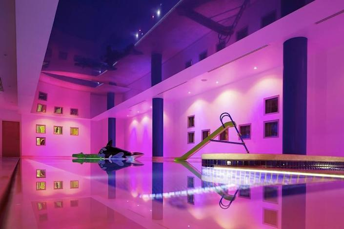 <p>The 9-acre property also has an indoor infinity pool with a water slide in a two-story natatorium. </p>