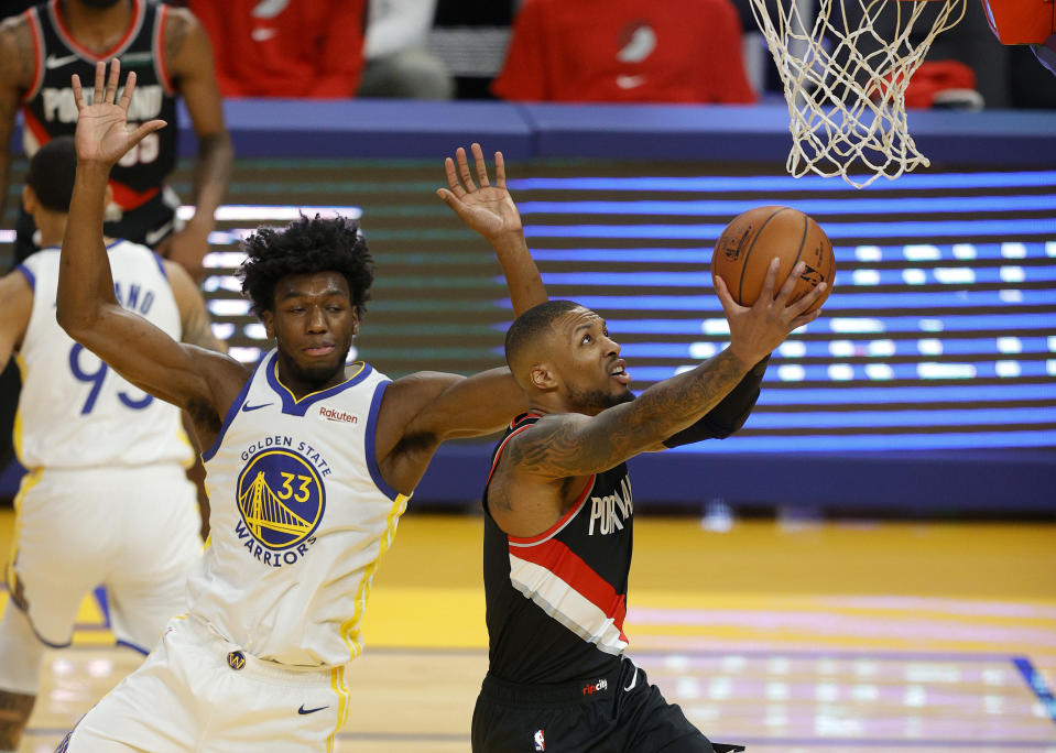 Oakland native Damian Lillard couldn't see family members during the Blazers' trip to play the Warriors on Friday. (Ezra Shaw/Getty Images)