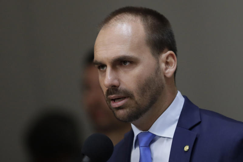 Brazilian Deputy Eduardo Bolsonaro, speaks during the opening of the International Seminar Challenges to National Defense and the role of the Armed Forces, in the Foreign Relations Committee of the Chamber of Deputies, in Brasilia, Brazil, Wednesday, Aug. 14, 2019. Federal prosecutors in Brazil filed a motion Monday that could block President Jair Bolsonaro's son, Eduardo, from becoming ambassador to Washington. (AP Photo/Eraldo Peres)