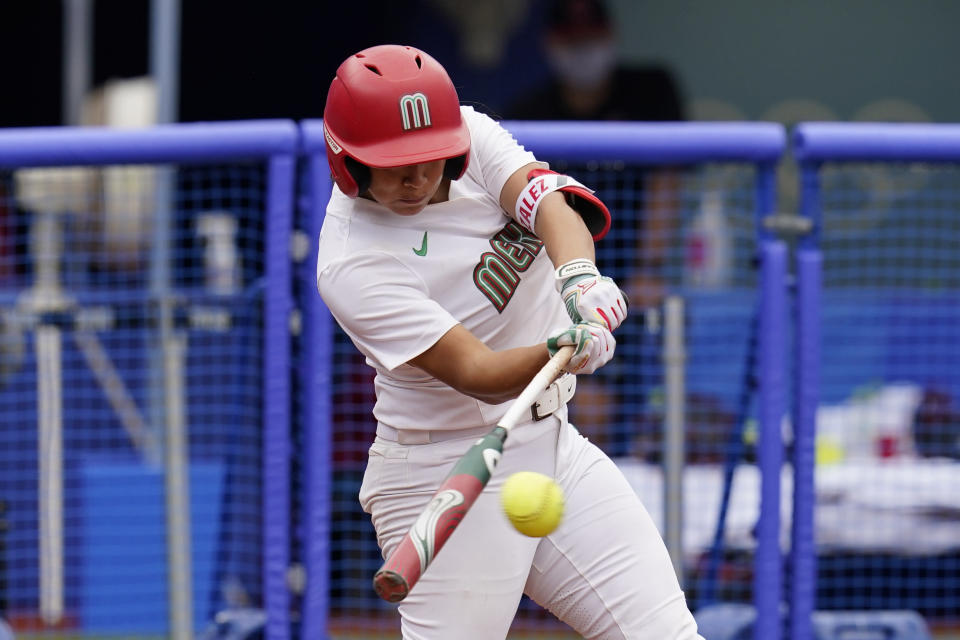 Mexico's Chelsea Gonzales hits a single in the sixth inning of a softball game against Canada at the 2020 Summer Olympics, Tuesday, July 27, 2021, in Yokohama, Japan (AP Photo/Sue Ogrocki)