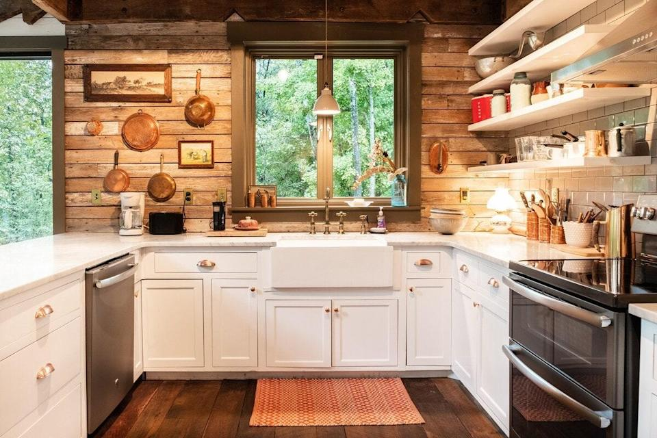 """<p>If reconnecting with nature is a top priority, this two-bedroom, one-bath cabin fits the bill with its floor-to-ceiling windows and 180-degree vistas. Set on 42 acres, yet just half an hour from Nashville International Airport, the views are of trees, trees, and more trees. Take in the scenery while preparing a meal in the state-of-the-art kitchen (we love those copper pots and pans) or birdwatching on the terrace. Cozy touches like a wood-burning stove and cushy leather furniture encourage travelers to silence their phones and disappear into a <a href=""""https://www.cntraveler.com/story/books-our-editors-are-reading-this-summer?mbid=synd_yahoo_rss"""" rel=""""nofollow noopener"""" target=""""_blank"""" data-ylk=""""slk:good book"""" class=""""link rapid-noclick-resp"""">good book</a>. </p> <p><strong>Book now:</strong> <a href=""""https://airbnb.pvxt.net/AJ3xx"""" rel=""""nofollow noopener"""" target=""""_blank"""" data-ylk=""""slk:From $153 per night, airbnb.com"""" class=""""link rapid-noclick-resp"""">From $153 per night, airbnb.com</a></p>"""