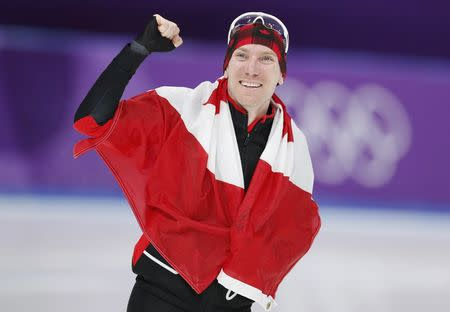 Speed Skating - Pyeongchang 2018 Winter Olympics - Men's 10000m competition finals - Gangneung Oval - Gangneung, South Korea - February 15, 2018 - Ted-Jan Bloemen of Canada celebrates after winning gold. REUTERS/John Sibley