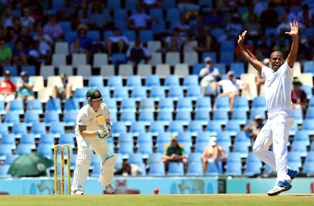 Australia's captain Michael Clarke, left, watches as South Africa's bowler Vernon Philander, right, unsuccessful appeals for LBW against him on the first day of their their cricket Test match at Centurion Park in Pretoria, South Africa, Wednesday, Feb. 12, 2014. (AP Photo/ Themba Hadebe)