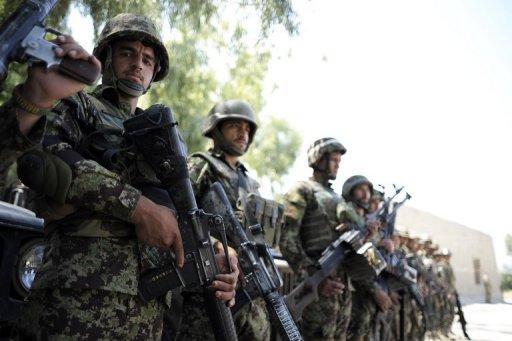 Soldiers of the 2nd Kandak, 2nd Brigade, 201st corps of the Afghan National Army stand in line at the Camp Joyce base
