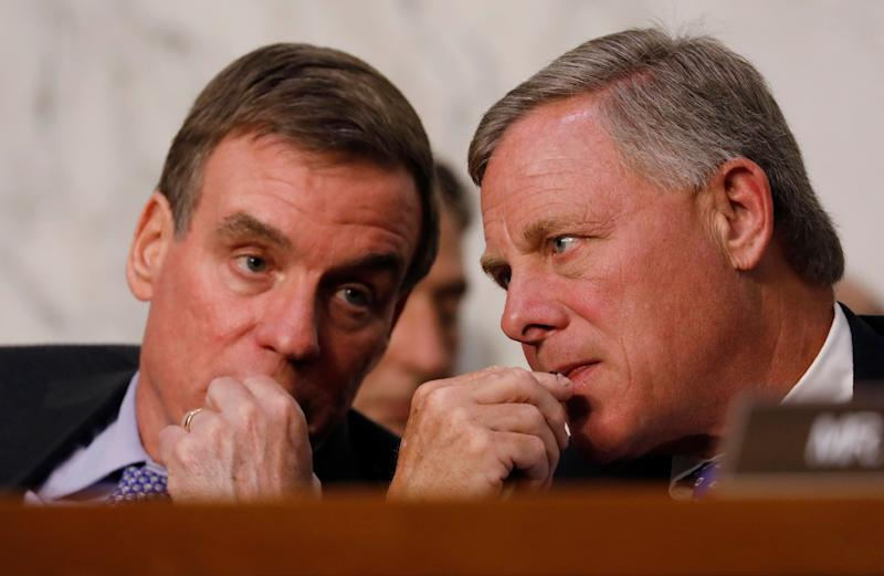 Senate Intelligence Committee vice chairman Sen. Mark Warner and chairman Sen. Richard Burr listen as U.S. Attorney General Jeff Sessions testifies before a Senate Intelligence Committee hearing on June 13, 2017.