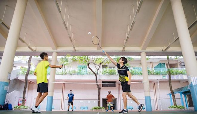 People play badminton at a sports facility in Diamond Hill. Photo: Winson Wong