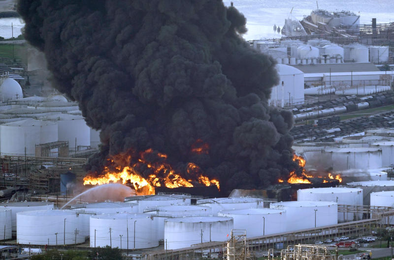 FILE - In this Monday, March 18, 2019 file photo, Firefighters battle a petrochemical fire at the Intercontinental Terminals Company in Deer Park, Texas. A fire at a Houston-area petrochemical storage facility that burned for days in March was accidental and caused by equipment failure at a storage tank, according to a report released by local and federal investigators, Friday, Dec. 6, 2019  (AP Photo/David J. Phillip, File)
