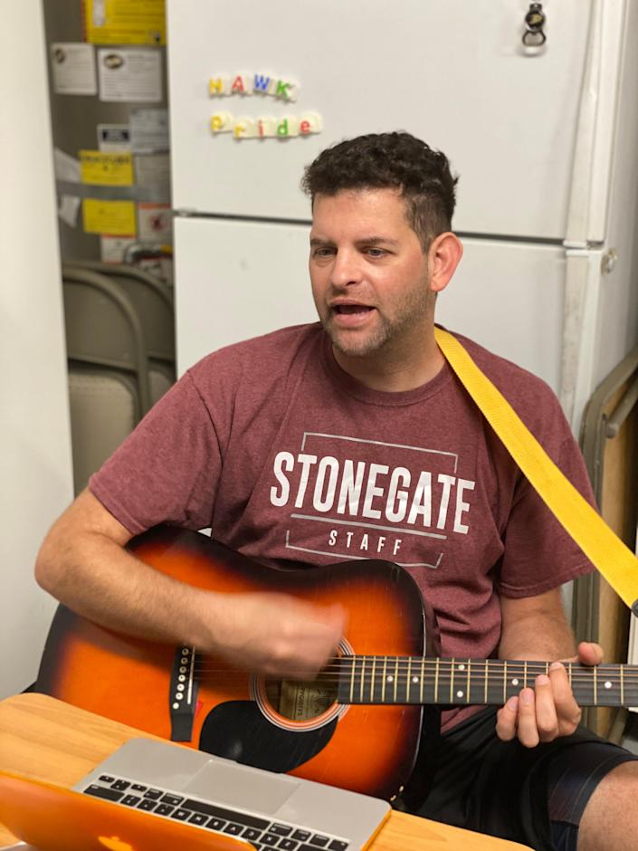 Brandon Wislocki, a fifth grade teacher at Stonegate Elementary School in Irvine, Calif., starts many of his virtual classes by singing to students.
