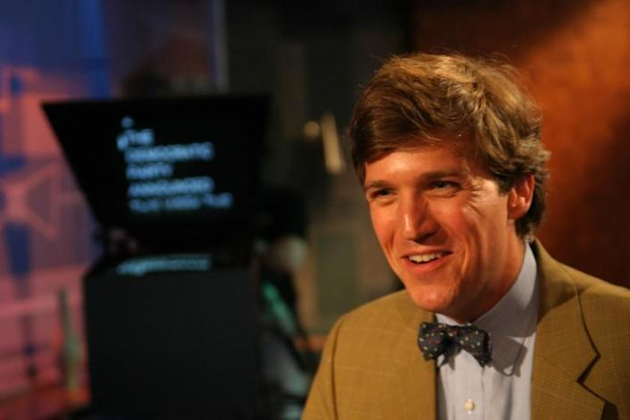 Tucker Carlson, seen here in 2004, is getting the 7 p.m. ET time slot on Fox News.