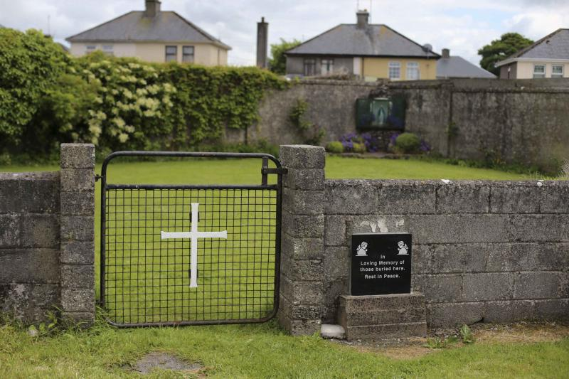The entrance to the site of a mass grave of hundreds of children who died in the former Bons Secours home for unmarried mothers is seen in Tuam, County Galway