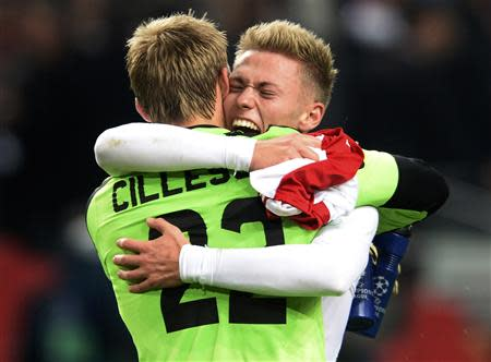 Ajax Amsterdam's player Viktor Fischer (R) and goalkeeper Jasper Cillessen (L) celebrate their victory against Barcelona after a Champions League group H soccer match at Amsterdam Arena November 26, 2013. REUTERS/Toussaint Kluiters