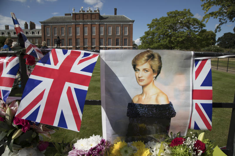 On the 20th anniversary of the death of Princess Diana, crowds of people gather to pay their respects, and to lay flowers, pictures and messages at the memorial to her on 31st August 2017 at Kensington Palace in London, United Kingdom. Diana, Princess of Wales became known as the People's Princess following her tragic death, and now as in 1997, thousands of royalists, and mourners came to her royal residence in remembrance. (photo by Mike Kemp/In Pictures via Getty Images Images)