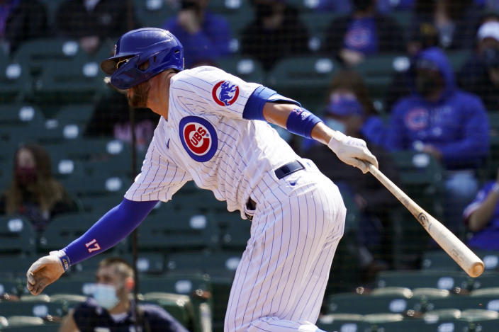 Chicago Cubs' Kris Bryant runs to first base after hitting a one-run single during the first inning of a baseball game against the Pittsburgh Pirates in Chicago, Sunday, April 4, 2021. (AP Photo/Nam Y. Huh)