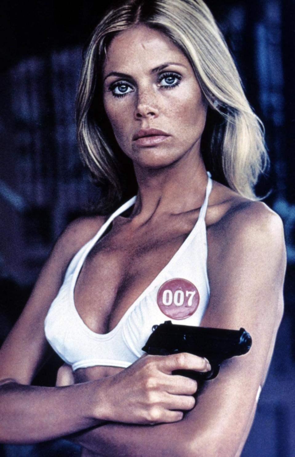 <p>Ekland was a Swedish model who contacted producers about the role, dying to be a Bond girl ever since she saw <i>Dr. No</i>. She played Goodnight, Bond's British assistant who helps him track assassin Francisco Scaramanga's car, but gets locked in the trunk in the process. <i>(Photo: Everett Collection)</i></p>